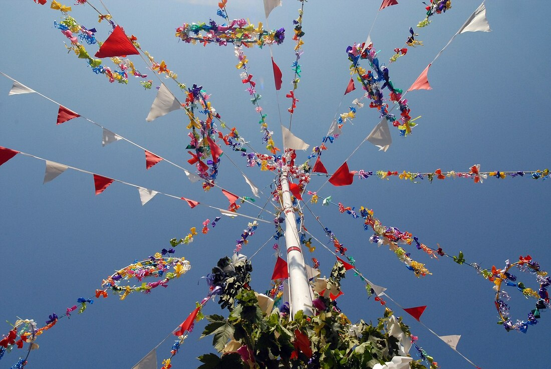 Top of a Maypole with colourful bunting