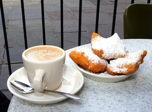 Beignet and coffee on a table in New Orleans, USA