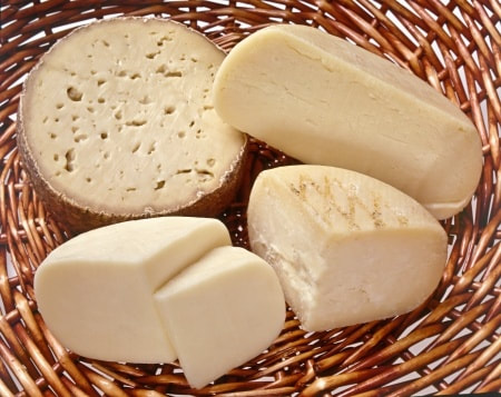 A selection of Greek cheeses in a basket