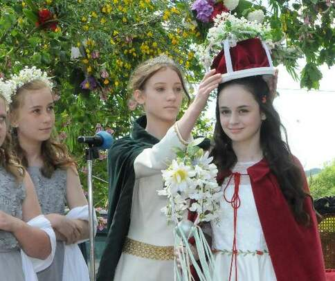 Girl being crowned as Queen of the May