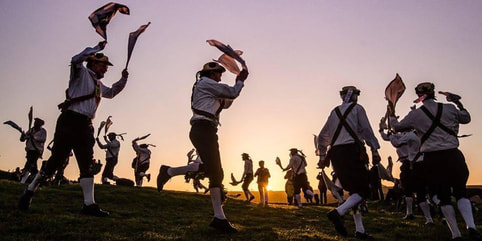 Morris dancers at dawn, Cerne Abbas, Dorset