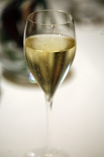 Glass of Taittinger champagne - By Charles Haynes from Hobart, Australia (Taittinger) [CC BY-SA 2.0  (http://creativecommons.org/licenses/by-sa/2.0)], via Wikimedia Commons