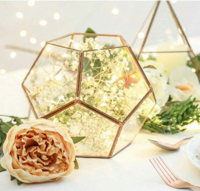 Geometric copper terrarium with peach rose wedding table decoration